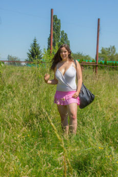 Thick hotty with giant saggy tits sunbathes nude in a field