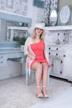 Jodie Dallas gives us a look at her white hat and lusty natural buxom assets and hair