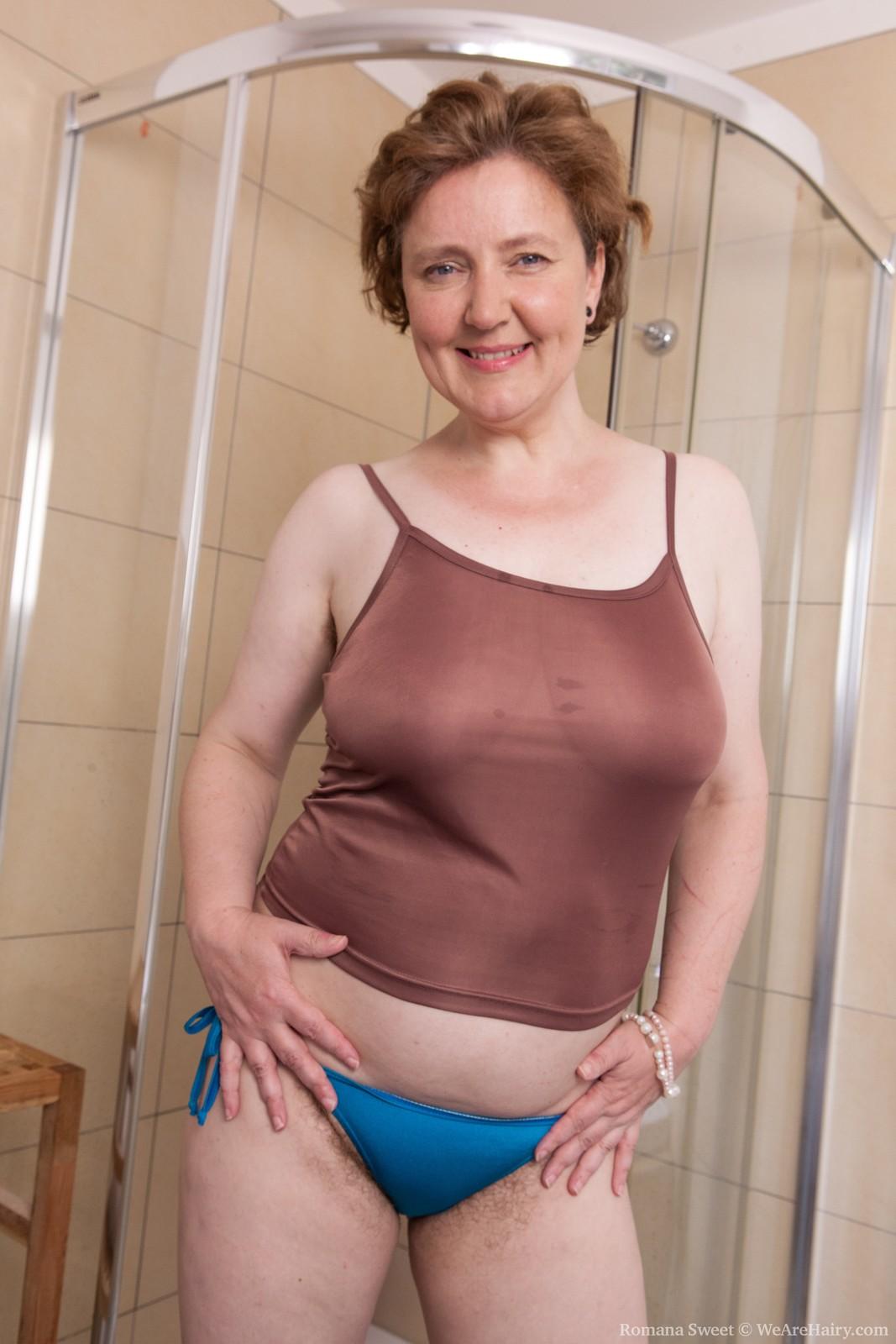 Romana Sweet wants to wash her bushy labia and showcase her sweet figure