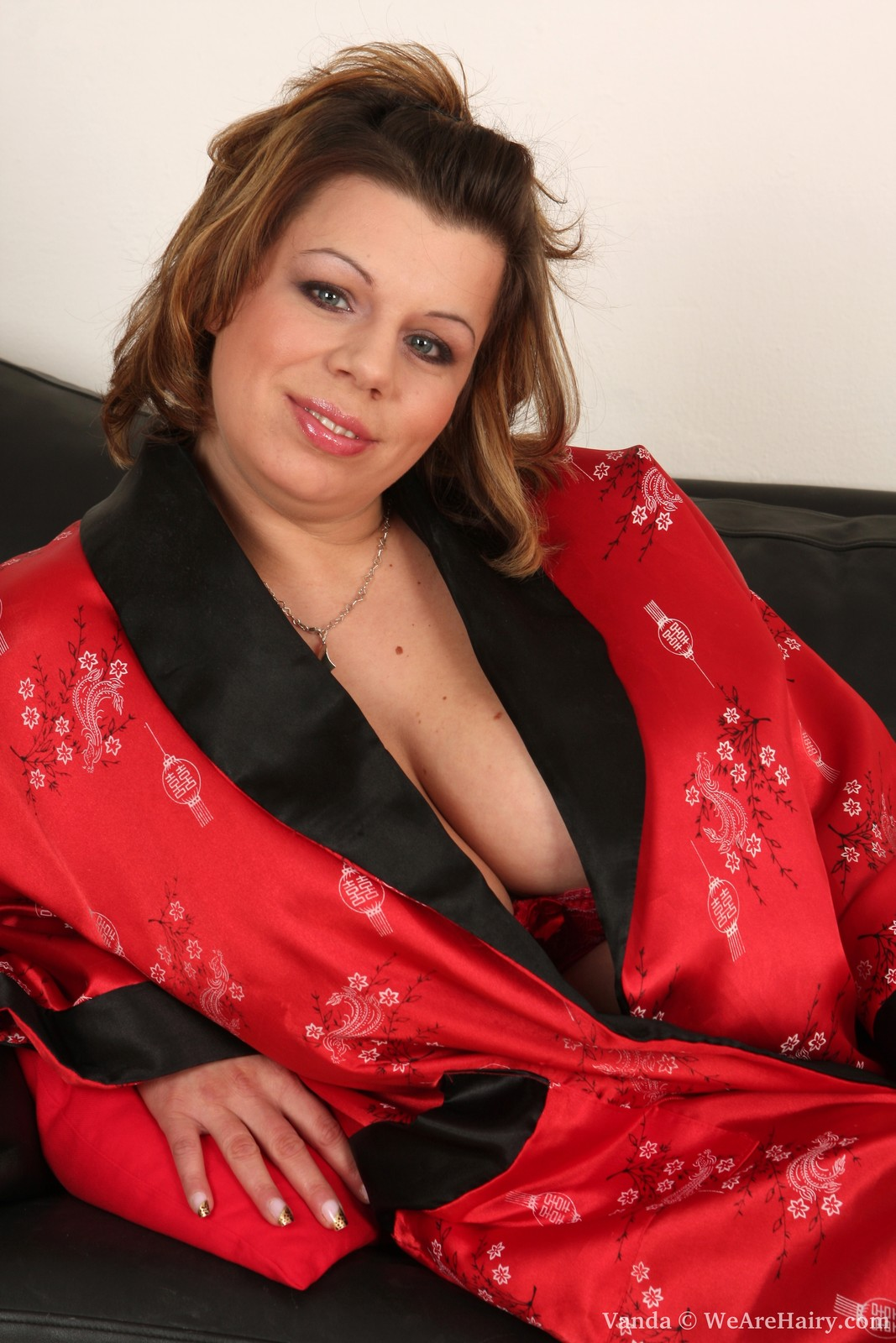 Busty BBW Vanda plays in her red lingerie and disrobes to show her unshaven pussy