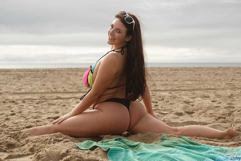Thick and curvy Angela White teases with her huge tits and big round ass at the beach